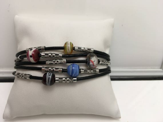 Bracelet leather and glass beads.