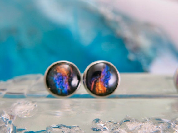 Round ear chip 12mmx12mm.  Cabochon made of glass.  Stainless steel stem. Hypoallergenic.