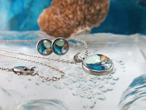 "Glass pendant and earrings set.  18 ""stainless steel chain.  Hypoallergenic"