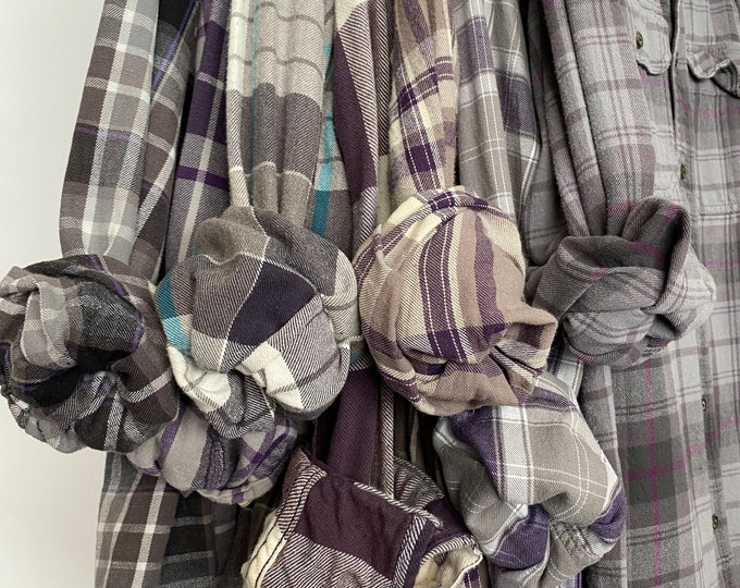 7 bridesmaid flannels curated as a set, colors are purple gray plum and mauve, sizes include small medium large