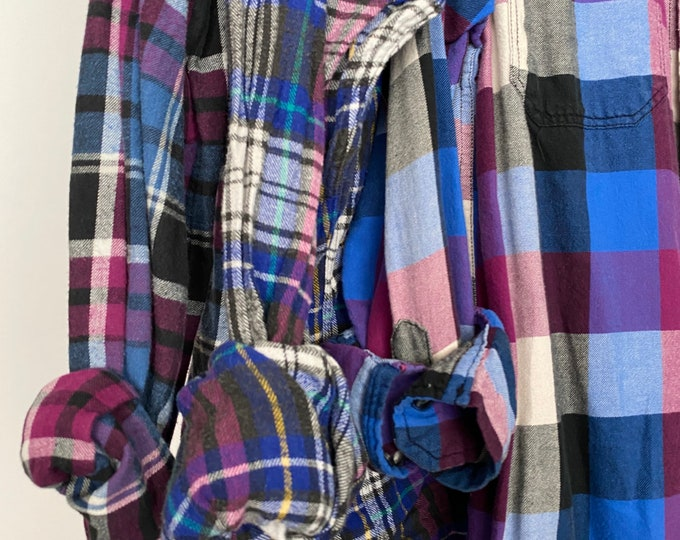 3 bridesmaid flannels curated as a set, colors are purple fuchsia and blue, sizes include XS medium and large, vintage mismatched flannel