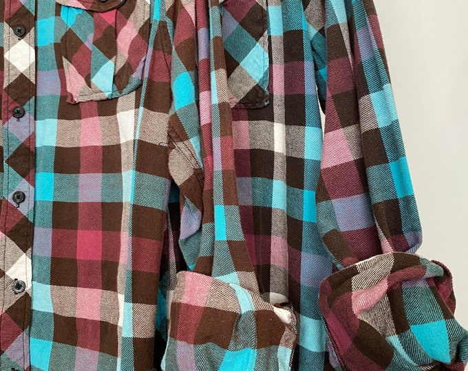 Small matching vintage flannel shirts curated as a set of 2, colors are plum turquoise and cocoa plaid