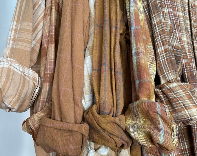 7 bridesmaid flannels curated as a set, colors are copper rust rose gold and mauve, sizes include medium large and Xlarge