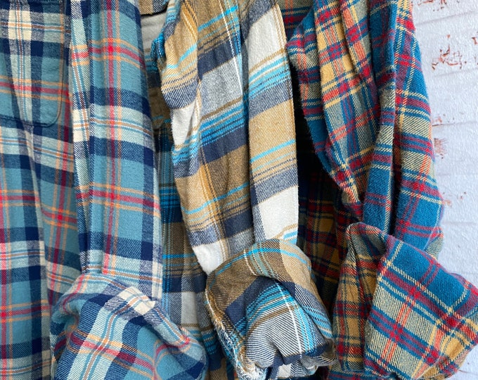 Medium vintage flannel shirts curated as a set of 3 in teal and tan shades