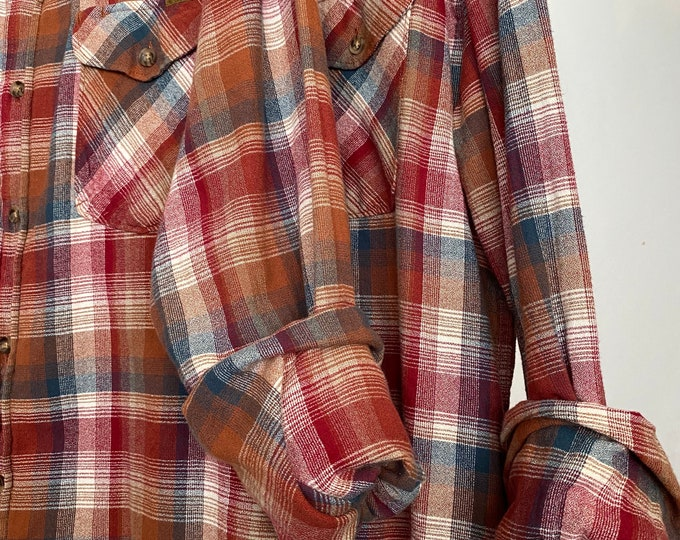 Medium vintage matching flannel shirts curated as a set of 2, colors are burgundy brown blue copper and rust
