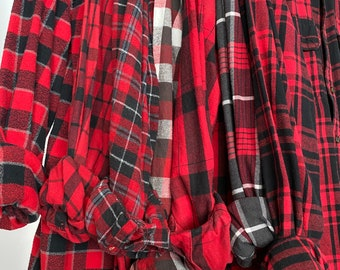 7 small flannel shirts curated as a set of mismatched bridesmaid flannels, color red plaids with bride shirt