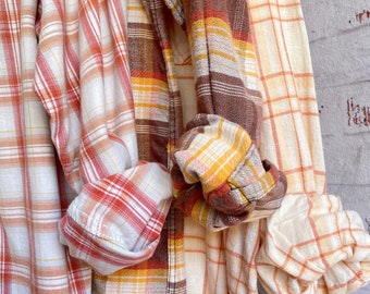 set of 3 flannels, colors are yellow orange and brown, sizes include small medium and 2X, vintage mismatched flannel shirts, bridesmaid