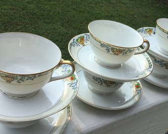 Meito China Teacups, Eight.  Meito Handpainted China Teacups.  Delphi Pattern Meito China Teacups.