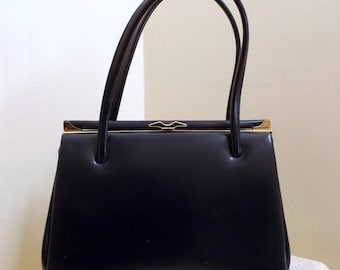 Navy blue faux leather vintage double handle kelly style handbag, leather lined