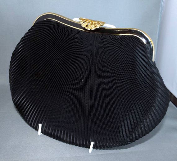 Black pleated satin evening bag with gold coloured