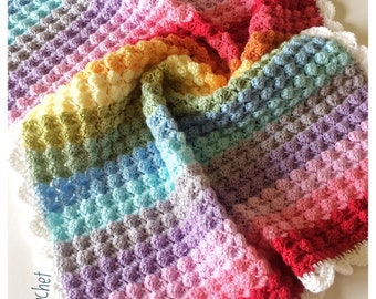 Handmade crochet baby blanket in rainbow colours