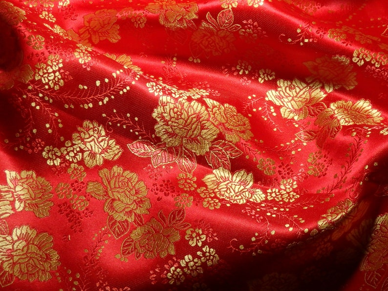 e944cfbc4 Chinese brocade fabric in vibrant red with a floral pattern in   Etsy