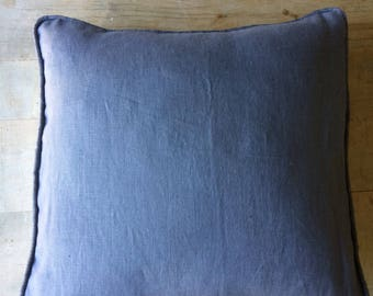 Grey linen cushion piped with metallic grey linen.