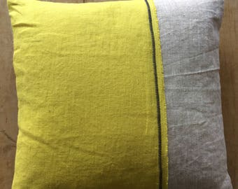 Yellow and natural linen cushion with navy zig zag detail.