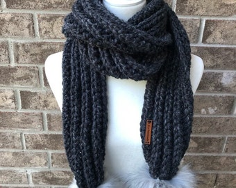 The COMBERMERE Oversized Pom Pom Scarf - Charcoal Grey w/Large Vixen Faux Fur Poms