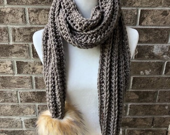 The COMBERMERE Oversized Pom Pom Scarf - Grey Taupe w/Large Toasted Marshmallow Faux Fur Poms