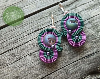 Small earrings made in soutache embroidery technique