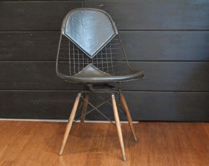 Eames PKW-2 wire 'bikini' chair - black leather on dowel swivel base, circa 1960s