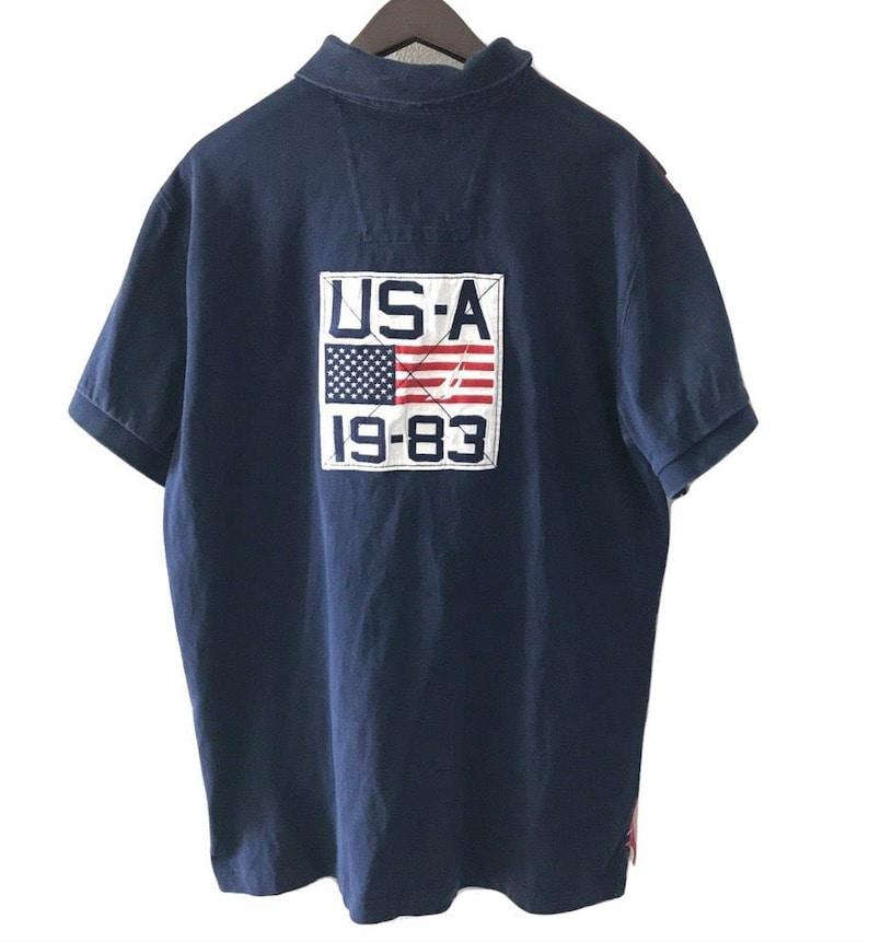 9feb9a978cc Vtg 90s Nautica Polo Shirt USA Flag Striped Sailing tee shirt | Etsy