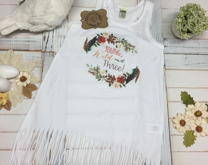 Featured listing image: Young, Wild and Three! Text with Watercolor Floral Wreath Design Girls Fringe Dress Design.  Also as a Bodysuit(Onesie) or Toddler T-Shirt!