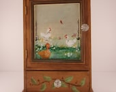Mimi cabinet with hens and chicks a redbird setting on the fence