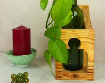Wall-mounted wooden bottle rack. Handmade.