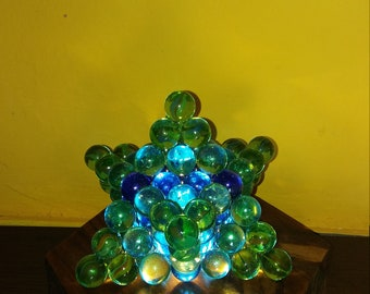 Handmade table lamp with marbles and wood. Merkaba.