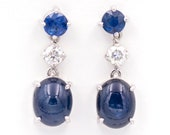 Long earrings made of 18K/750 white gold with 6.53 ct. of sapphires, 1.62 ct. and 0.36 ct. of diamonds.