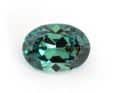 Oval-cut natural bluish green tourmaline , weight: 0.84 ct.