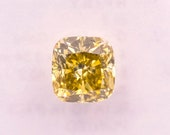 Natural fancy intense brownish yellow diamond - cushion cut of 0.64 ct - SI2 - IGI Certificate.