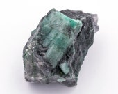 Raw emerald stone of 66 grams with matrix of black mica and quartz.