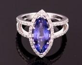Ring -  White Gold 18k/750 - Natural violetish blue tanzanite of 4 ct. - IGI Report -  White diamonds of 0.55 ct. - Size: 6 1/4 (US)