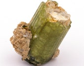 Raw green tourmaline stone of 42 grams in matrix.