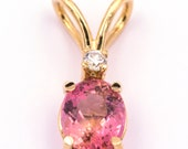 Pendant made of 18k/750 yellow gold with oval pink tourmaline of 3.05 ct. and brilliant diamond of 0.12 ct.
