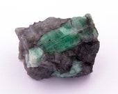 Raw emerald stone of 71 grams with matrix of black mica and quartz.