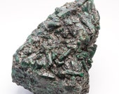 Great raw emerald stone of 13.7 kilograms with matrix of black mica and quartz.