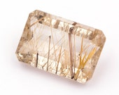 Emerald-cut natural rutilated quartz, weight: 17.20 ct.
