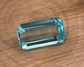 Natural light blue to blue aquamarine of 18.11 ct. - Measurements: 20.96 x 11.65 x 8.78 mm. - Rectangular emerald cut. - Origin Brazil.