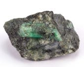 Raw emerald stone of 110 grams with matrix of black mica and quartz.
