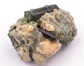 Raw deep green tourmaline stone of 43 grams in matrix of quartz.
