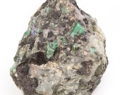 Great raw emerald stone of 4 kilograms with matrix of black mica and quartz.