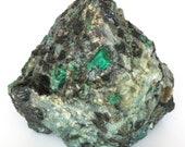 Great raw emerald stone of 4 kilograms with matrix of black mica and quartz.