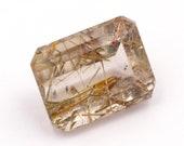 Emerald-cut natural rutilated quartz, weight: 10.25 ct.