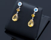Long earrings made of 18K/750 white gold with 9.80 ct. of citrines, 0.60 ct. of blue topazes and 0.32 ct. of diamonds.