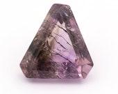 Natural rutile amethyst quartz, fantasy triangular cut , weight: 12.35 ct.
