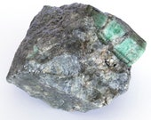 Big crystal of green emerald on black mica and quartz. - Weight: 916 grams.