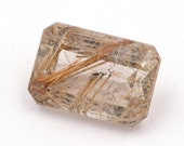 Emerald-cut natural rutilated quartz, weight: 7.65 ct.