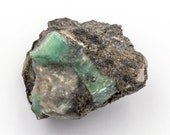 Raw emerald stone of 79 grams with matrix of black mica and quartz.
