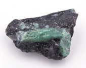 Raw emerald stone of 78 grams with matrix of black mica and quartz.