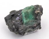 Raw emerald stone of 33 grams with matrix of black mica and quartz.